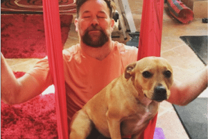 Lehmo with his dog Buddy trying Arial Yoga
